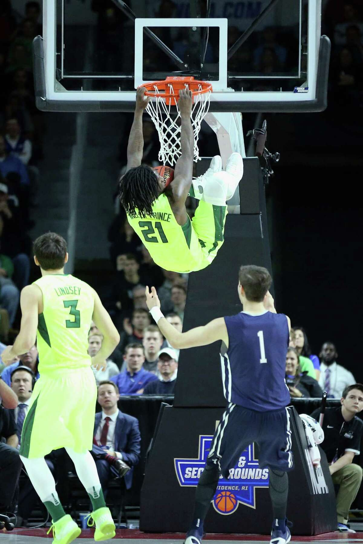 PROVIDENCE, RI - MARCH 17: Taurean Prince #21 of the Baylor Bears dunks the ball in the first half against the Yale Bulldogs during the first round of the 2016 NCAA Men's Basketball Tournament at Dunkin' Donuts Center on March 17, 2016 in Providence, Rhode Island.