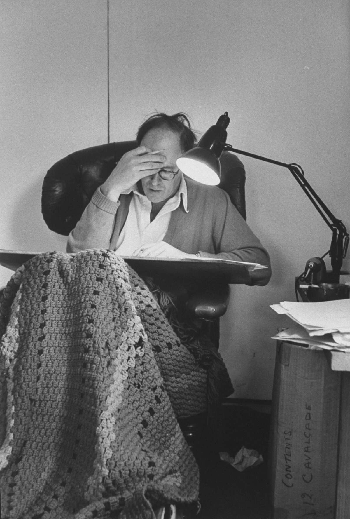 Author Roald Dahl at work in his usual writing chair. The chair had a hole in the back to relieve the pressure on his sore back.