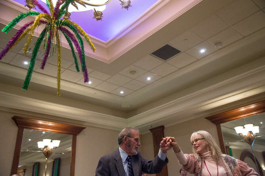 """Doug Behr and Vivian Stafford, of Midland, dance the rumba to music performed by the Kadenza Jazz Trio during """"The World's Greatest Mardi Gras Feast"""" benefit for The Legacy Center for Community Success at the Great Hall Banquet and Convention Center in Midland on Tuesday evening. """"We've been friends for 30 years, at least,"""" said Behr. """"We actually met at a class I was teaching at Delta College,"""" added Stafford, who owns and teaches at Stafford Ballroom and Line Dance. Photo: Zack Wittman 