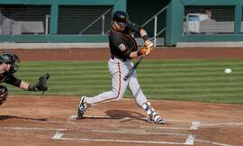 Christian Arroyo, 82 connects for a double at his first at bat as the San Francisco Giants play an intrasquad game during spring training at Scottsdale Stadium on Tues. March 1,  2016, in Scottsdale, Arizona.