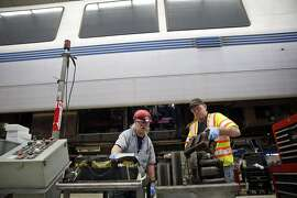 BART Transit Vehicle Electronic Technicians Jay Clemons, (left) and Timothy Ryan inspect thyristors at the BART maintenance facility in Concord, Calif., on Thursday, March 17, 2016.