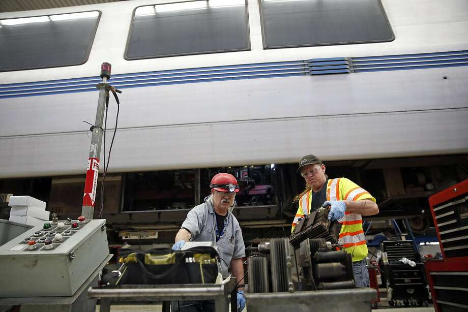 BART vehicle technicians Jay Clemons (left) and Timothy Ryan inspect thyristors, the parts being damaged in railcars by mysterious power surges in the system, at the maintenance facility in Concord. Photo: Scott Strazzante, The Chronicle