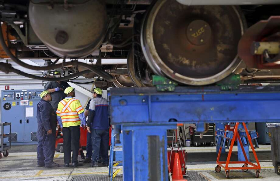 Workers inspect a train at the BART maintenance facility in Concord, Calif., on Thursday, March 17, 2016. Photo: Scott Strazzante, The Chronicle