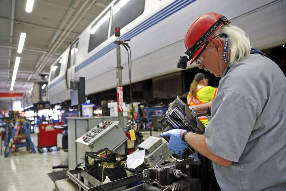 BART Transit Vehicle Electronic Technicians Jay Clemons, (right) and Timothy Ryan inspect thyristors at the BART maintenance facility in Concord, Calif., on Thursday, March 17, 2016. Photo: Scott Strazzante, The Chronicle