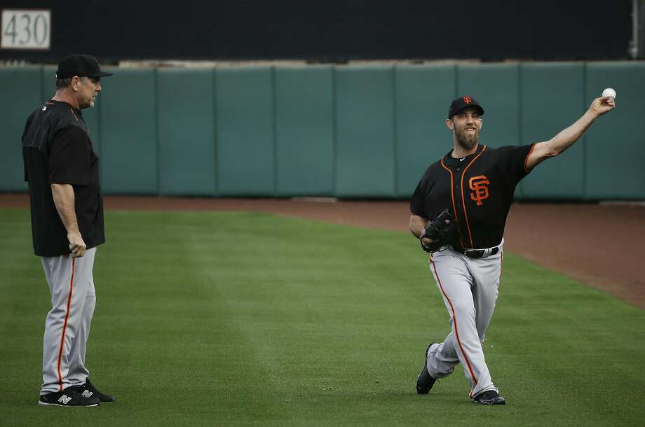 San Francisco Giants manager Bruce Bochy watches starting pitcher Madison Bumgarner throw during practice before the spring baseball season in Scottsdale, Ariz., Thursday, Feb. 18, 2016. (AP Photo/Chris Carlson) Photo: Chris Carlson, AP