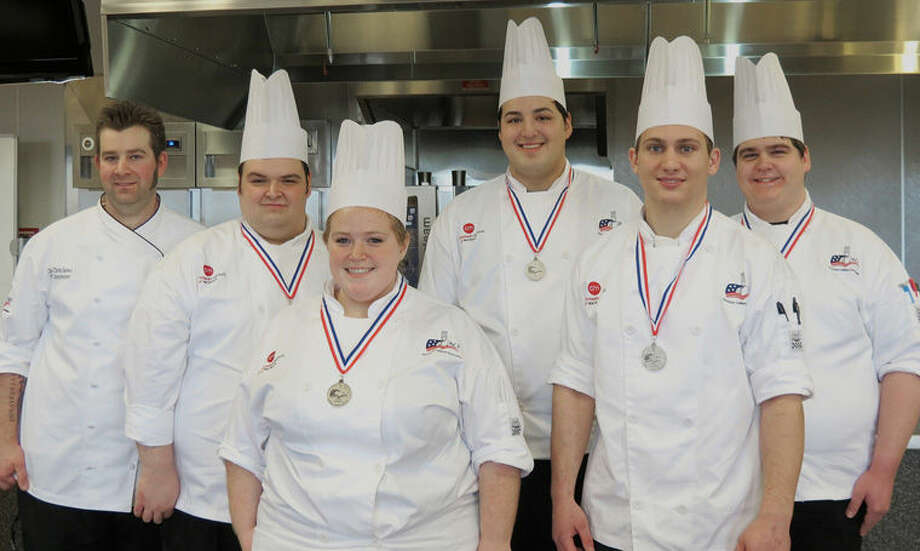 Earning the silver medal at the Michigan 2015 American Culinary Federation Student Team State Competition are CIM Muskegon culinary students, beginning second from left, team captain Mike Kenat, Jaclyn Yablon, Alejandro Guzman, Robert White and Zachary Hency. At left is team coach Chris Sowa, CIM Muskegon chef instructor. Photo: Photo Provided