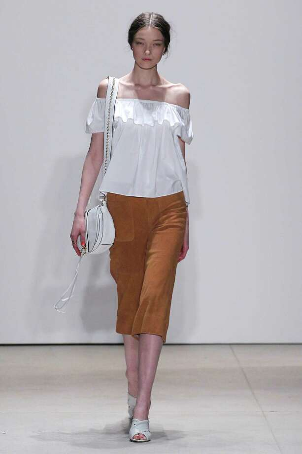 A model wears a trendy off-the-shoulder blouse during the Rebecca Minkoff show during the recent New York Fashion Week Spring 2016. Photo: Edward James / WireImage / 2016 Edward James