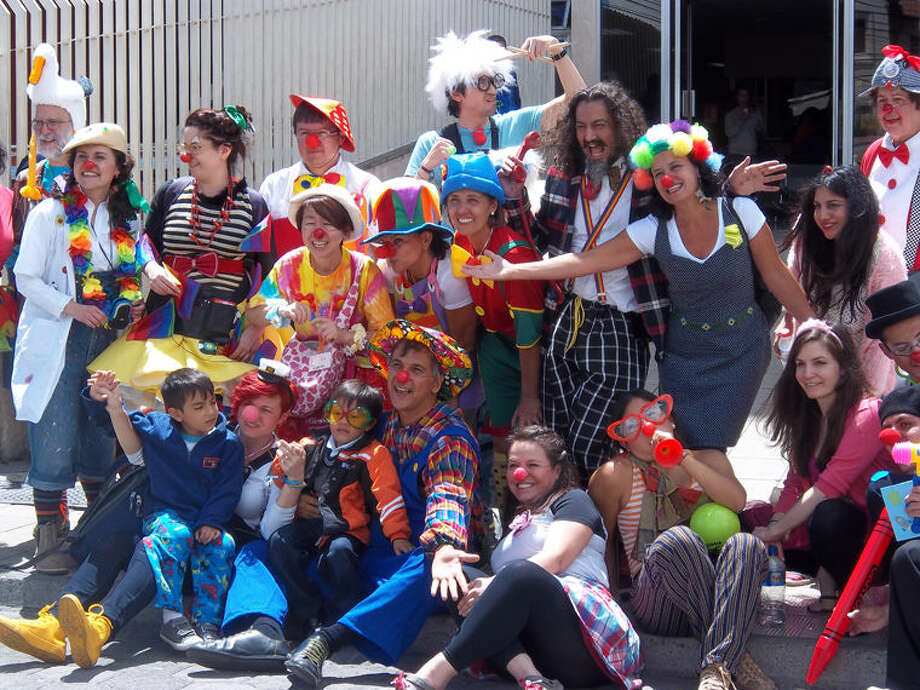 Clown workshop members gather for a photo in front of the children's hospital in Quito, Ecuador. People everywhere — patients and staff — wanted their pictures taken with the group. Photo: Photo Provided