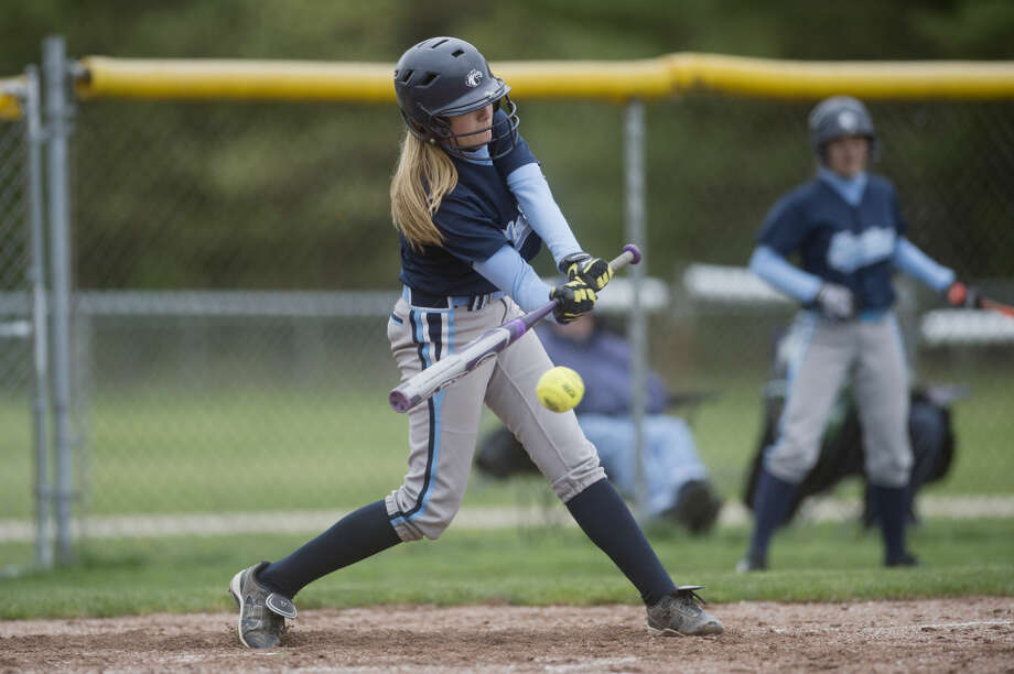 Meridian's Haley Maynard hits the ball but was out at first during the first game of a doubleheader against Farwell at Meridian High School on Tuesday. Photo: Neil Blake/Midland Daily News