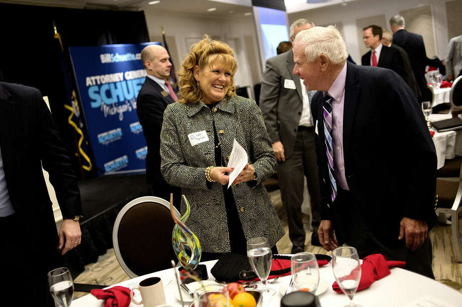 John Bartos, right, congratulates Patti Kepler, left, after Patti and her husband, Dave, received the Margaret Ann Riecker Meritorious Service Award during the Midland County Republican Party Dave Camp Spring Breakfast on Monday at the H Hotel. Photo: Nick King | Nking@mdn.net