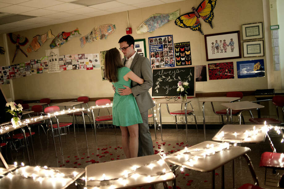 Brandon Bowser, right, dances with fiancée Sarah Robison after a surprise marriage proposal in the classroom of their seventh grade teacher, Sandy Collinson, on Saturday at Jefferson Middle School. Photo: Nick King | Nking@mdn.net