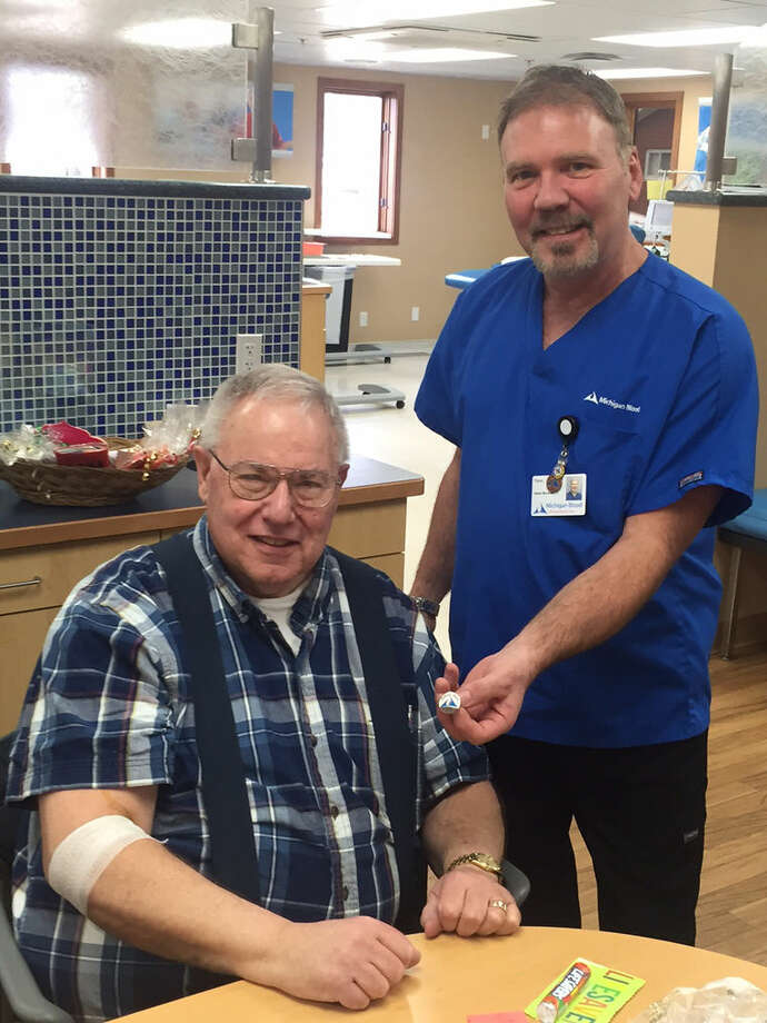Dale Bement of Midland recently hit the 33 gallon mark in blood donations. He is pictured with Timm Ehlers of Michigan Blood Photo: Photo Provided