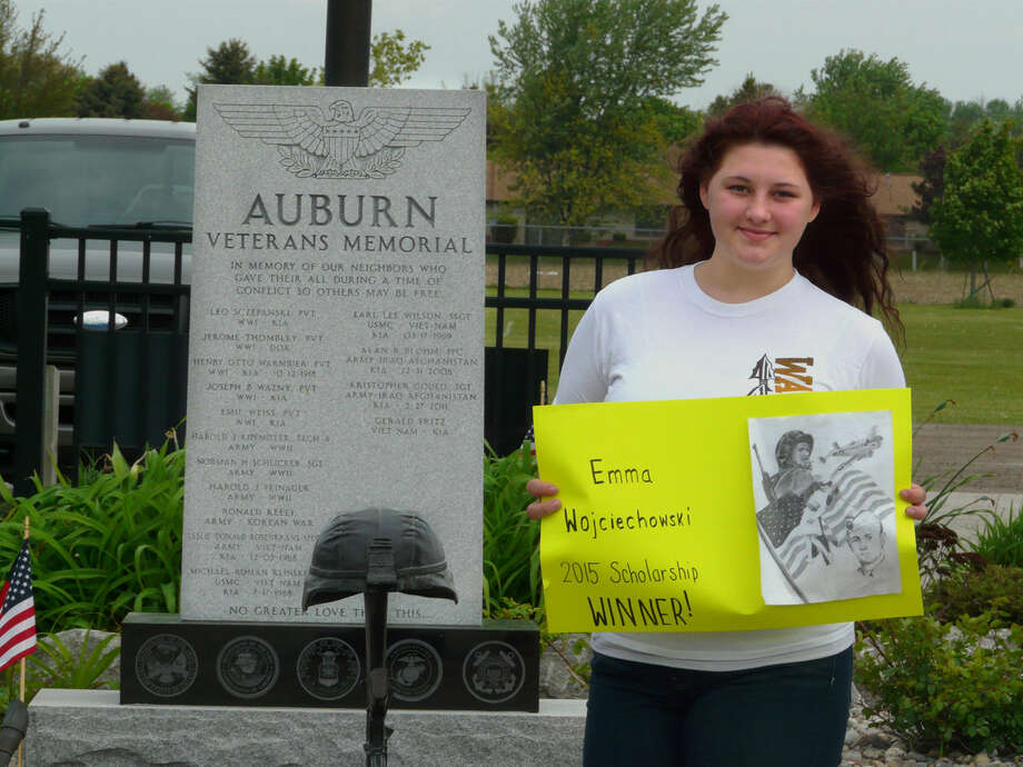 Emma Wojciechowski, a sophomore at Bay City Western, stands in front of the Auburn Veterans Memorial displaying her award-winning art work. Wojciechowski's pencil drawing depicting World War II images captured the top prize, a $1,000 college scholarship, in the Auburn Veterans Memorial Committee's first Design a Memorial Wall contest. Photo: Jon Becker | For The Daily News