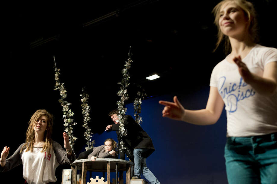 "Midland High School students, from left, Grace Goddard, Sophia Bagnall, Jared Lane and Gloria Heye rehearse a scene from William Shakespeare's ""A Midsummer Night's Dream"" to prepare for the Michigan Interscholastic Forensic Association state finals. The students have 45 minutes to produce the play in front of judges who will evaluate the show on its acting and special techniques. Photo: BRITTNEY LOHMILLER 