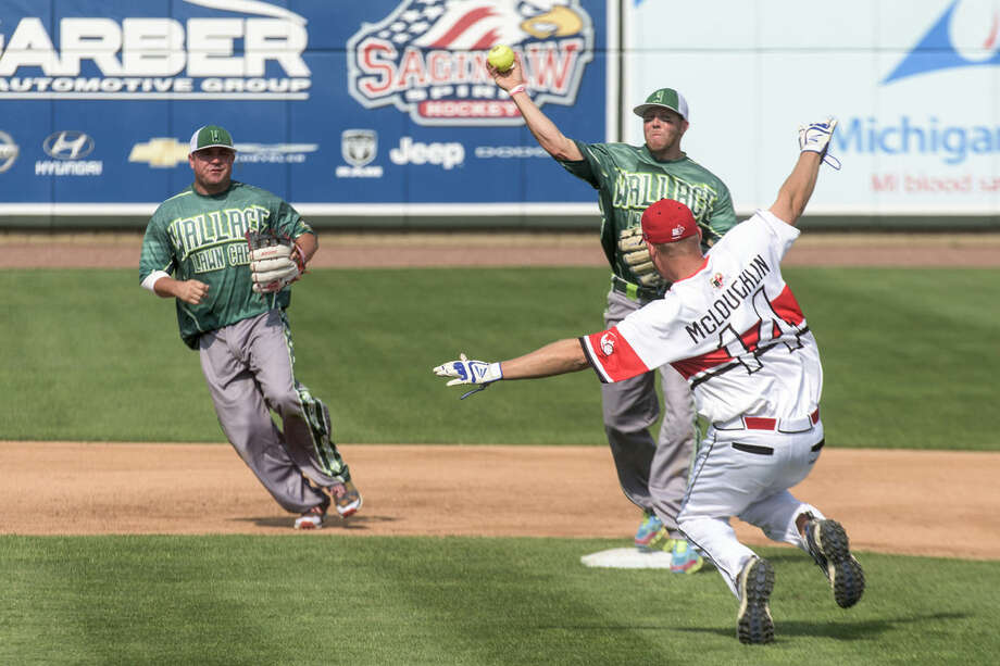 Canada Select's Dustin McLoughlin begins to slide into second as Wallace Landscaping's Jeff Payton of Davison throws the ball to first to make a double play at Dow Diamond. Photo: Danielle McGrew | For The Daily News