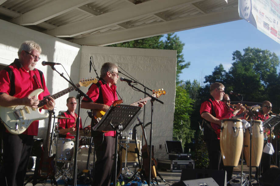 The Hit Men, a Midland-based band, performed recently as part of the 16th annual Concerts in the Park series in Titabawassee Township Park. Photo: Stuart M. Frohm For The Daily News