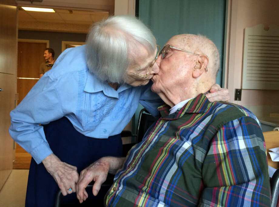 Walter and Leslie Kimmel, who are both 100 years old, enjoy a kiss as they celebrate their 75th wedding anniversary Tuesday at Charlestown Retirement Community in Catonsville, Md. The Kimmels met at Emmanuel Lutheran Church in Baltimore when they were 22 years old. Leslie played the organ and Walter sang in the choir. Photo: Paul J. Kessler | WBFF-TV Via AP