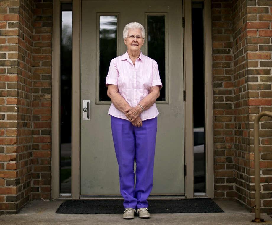 Longtime Midland County Pregnancy Aid volunteer Frieda Dubay, 84, of Sanford, poses outside St. Paul's Lutheran Church in Sanford. Photo: Erin Kirkland | Midland Daily News