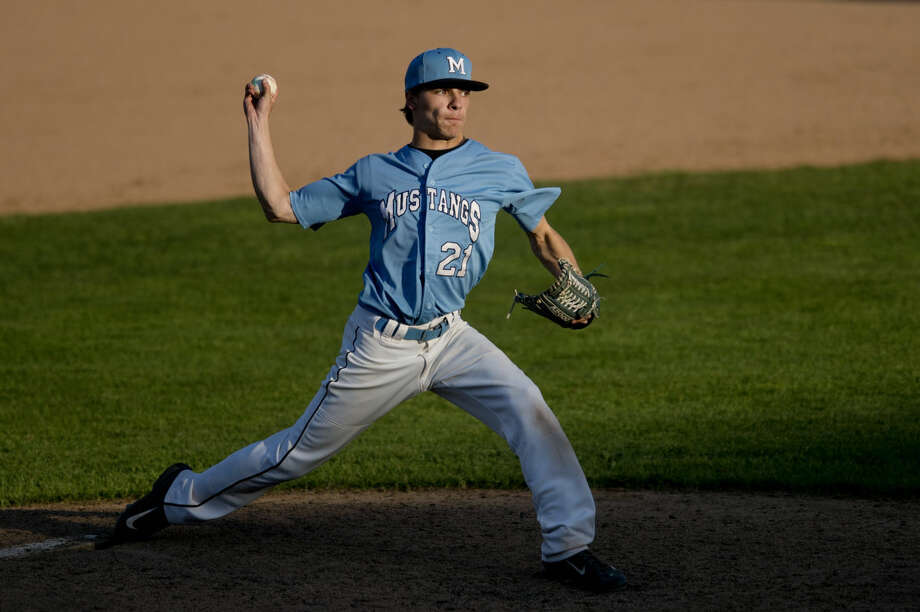 Meridian's Monte Petre pitches during a game against St. Charles at Dow Diamond on Thursday. Meridian won 14-0 in five innings. Photo: Neil Blake | Midland Daily News