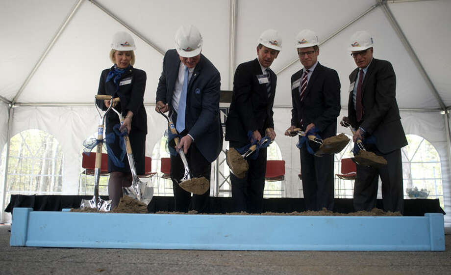 From left: Northwood University Executive Vice President Kristin Stehouwer, Northwood University President and CEO Keith Pretty, Northwood University Chair Board of Trustees Chairman Dan DeVos, President of Triangle Association Mitchell Watt and President and CEO of TowerPinkster Architects Arnie Mikon turn dirt at the ground breaking ceremony for the DeVos Graduate School of Management building Friday afternoon. The new building is expected to be completed in May of 2016. Photo: Brittney Lohmiller/Midland Daily News