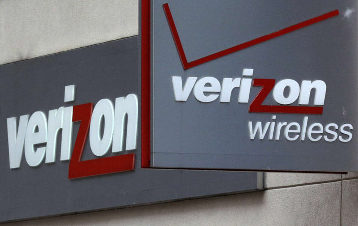 This file photo shows signage at a Verizon Wireless retail store at Downtown Crossing in Boston.