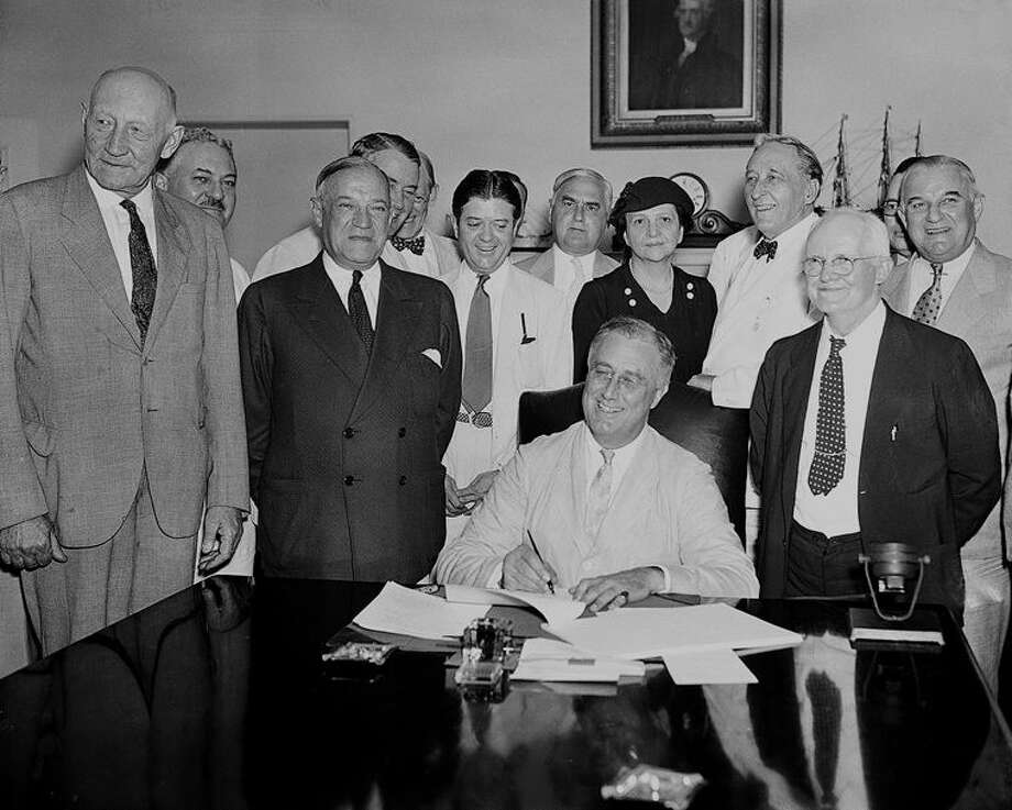 This Aug. 14, 1935, file photo shows President Franklin D. Roosevelt signing the Social Security Bill in Washington. As Social Security approaches its 80th birthday on Aug. 14, 2015, the federal government's largest benefit program faces serious financial problems that could be fixed with only modest changes, if Congress acts quickly. Photo: AP Photo, File