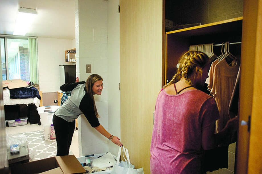 BRITTNEY LOHMILLER | blohmiller@mdn.net Lexi Ford, left, of Troy, jokes with her friend, Samantha Gotinsky of Troy, while moving into her dorm room at Northwood University Friday morning. This is Ford's first year at Northwood. Photo: Brittney Lohmiller/Midland Daily News