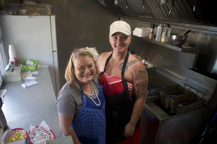 Beverly Dietzel, left, of Midland and her daughter Melinda Sprague started their food truck business, Blondy's BrunchBox and Catering, this summer. Photo: Brittney Lohmiller/Midland Daily News