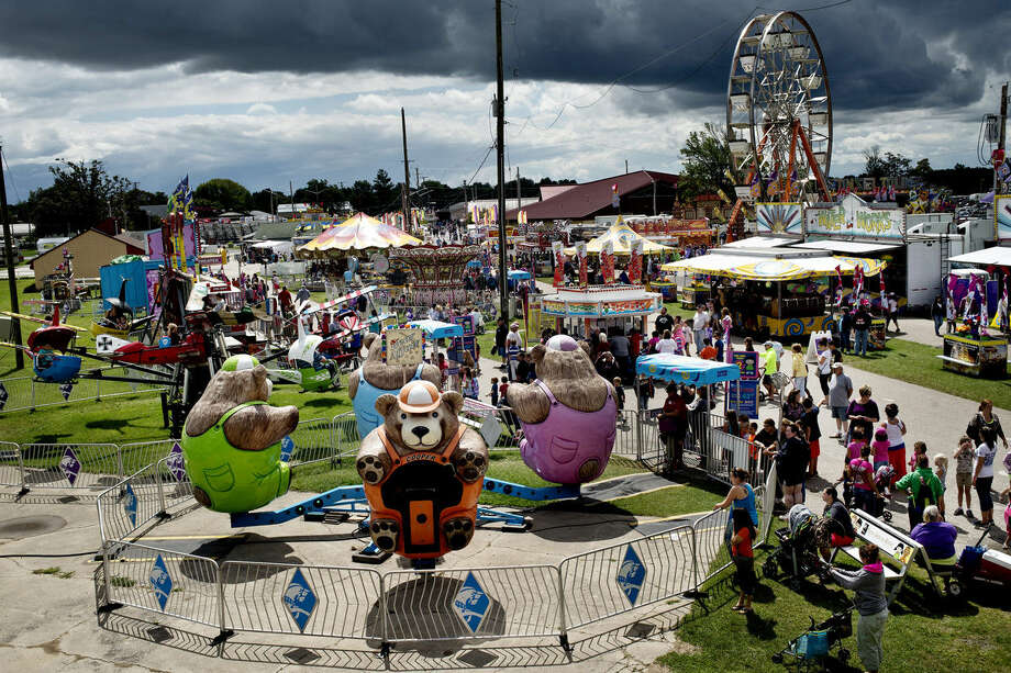 The Bear Affair fair ride continues to spin just before an afternoon rainfall at the Midland County Fairgrounds on Thursday in Midland. Photo: Erin Kirkland | Midland Daily News