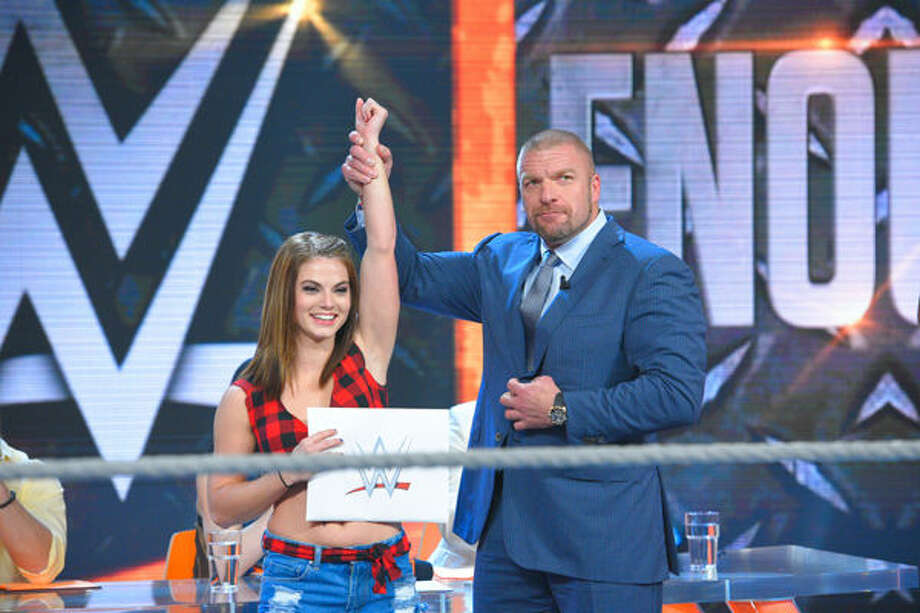 Hope's Sara Lee with WWE Executive Vice President Triple H.