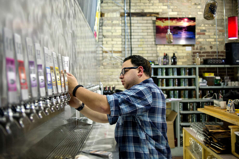WhichCraft Taproom features more than 80 varieties of craft-brewed Michigan beer, 40 of which are available on tap. The business is one of several in the region featuring craft beer. Photo: NICK KING | Nking@mdn.net