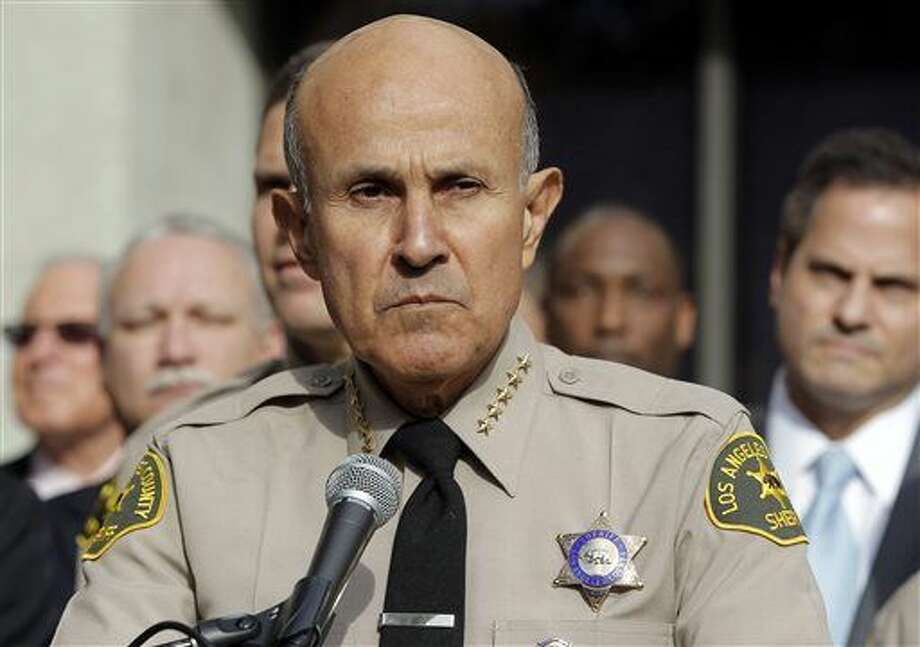 FILE - In this Jan. 7, 2014, file photo, Los Angeles County Sheriff Lee Baca announces his retirement at a news conference at Sheriff's Headquarters Bureau in Monterey Park, Calif. The Los Angeles Times has obtained a recorded interview revealing the lies Baca told federal authorities who were investigating corruption at the jails he ran. Baca denied knowing about efforts to stifle the probe into abuse at the jails by hiding an inmate who was working as an FBI informant. The former sheriff pleaded guilty to lying to investigators during a federal corruption probe that tainted his career Wednesday, Feb. 10, 2016. (AP Photo/Nick Ut, File) Photo: Nick Ut