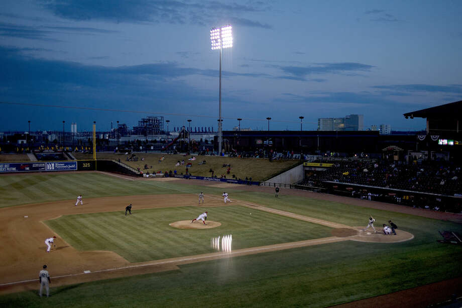 As the sun sets over the field, the Great Lakes Loons play a game at Dow Diamond. Photo: NICK KING | Nking@mdn.net