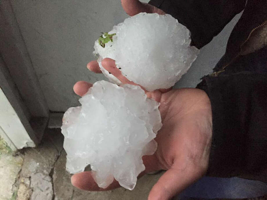 Softball sized hail fell just north of West Branch Sunday. The photo was submitted by Shelly Evergreen. Photo: Shelly Evergreen