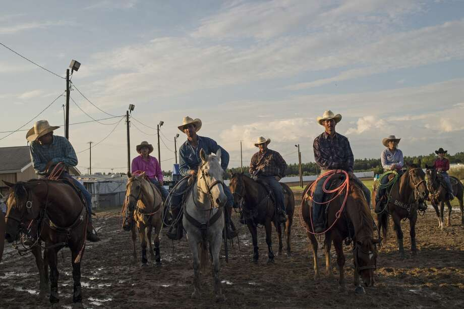 Midland County Fair Championship Rodeo participants wait for the event to start at the Midland County Fairgrounds in Midland on Wednesday. The event featured bull riding, barrel racing and more. Photo: Erin Kirkland