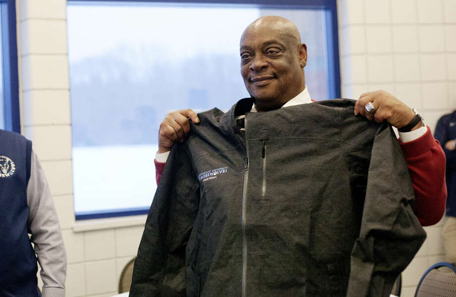 Larry Lindsey holds up a Northwood University football jacket that he was given during his retirement party. Photo: NEIL BLAKE | Nblake@mdn.net
