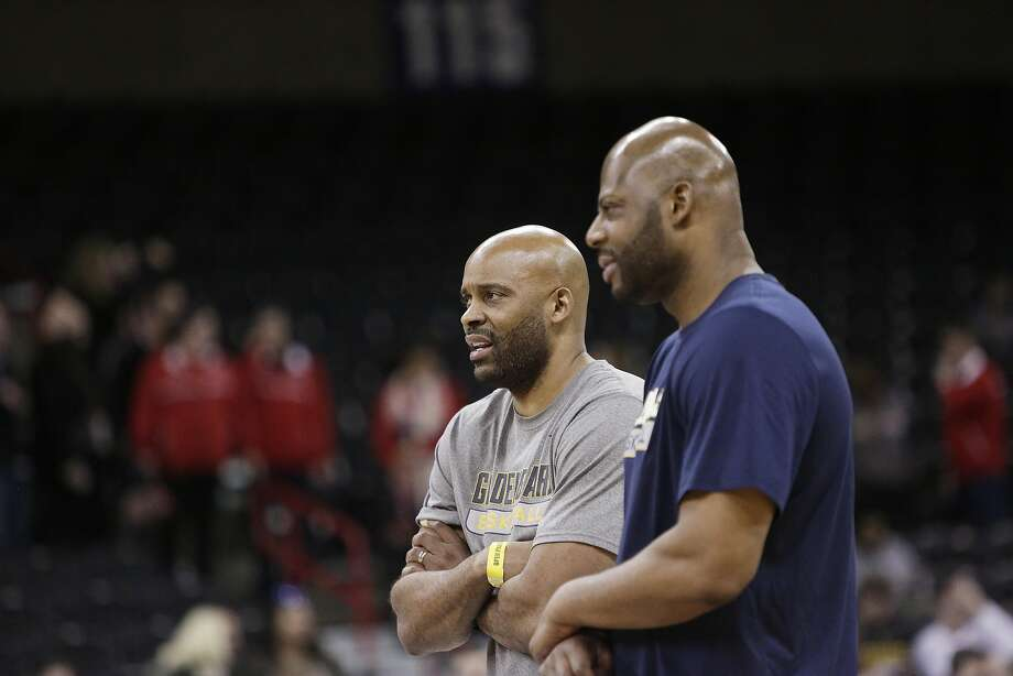 Former Cal head coach Cuonzo Martin, left, speaks with the new head coach Wyking Jones during practice a day before a first round men's college basketball game against Hawaii in the NCAA Tournament in Spokane, Wash., Thursday, March 17, 2016. (AP Photo/Young Kwak) Photo: Young Kwak, AP