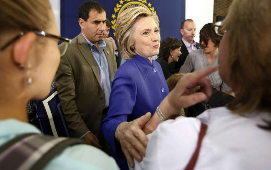 Democratic presidential candidate Hillary Rodham Clinton meets with voters during a campaign stop at River Valley Community College Tuesday, Aug. 11, 2015, in Claremont,NH (AP Photo/Jim Cole) Photo: Jim Cole