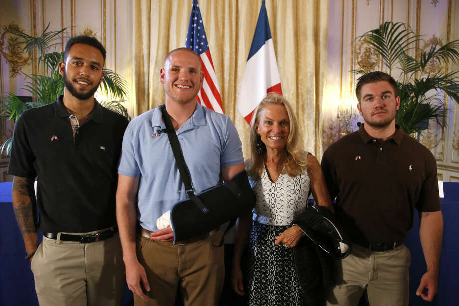 Anthony Sadler, a senior at Sacramento University in California, left, U.S. National Guardsman from Roseburg, Oregon, Alek Skarlatos, right, and U.S. Airman Spencer Stone, second from left, pose for photographers with Jane D. Hartley, U.S. Ambassador to France, before a press conference held at the U.S. Ambassador's residence in Paris, France, on Sunday. Sadler, Skarlatos and Stone helped foil a potentially deadly attack when they subdued a man armed with an assault rifle and other weapons on board a high-speed train bound for Paris two days ago. The man was known to intelligence services in three countries and had ties to radical Islam, authorities said Sunday. Photo: Francois Mori | AP Photo