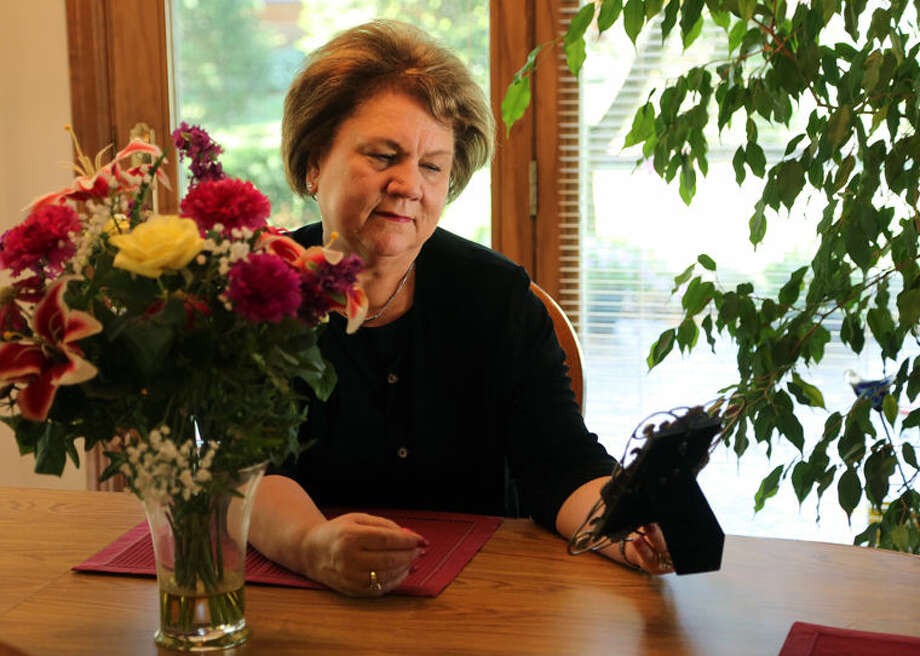Peggy Dzierzawski reflects on memories shared with her mother. Hospice of Michigan said that finding opportunities to remember a lost loved one is a very healthy way to work through grief. Photo: Photo Provided