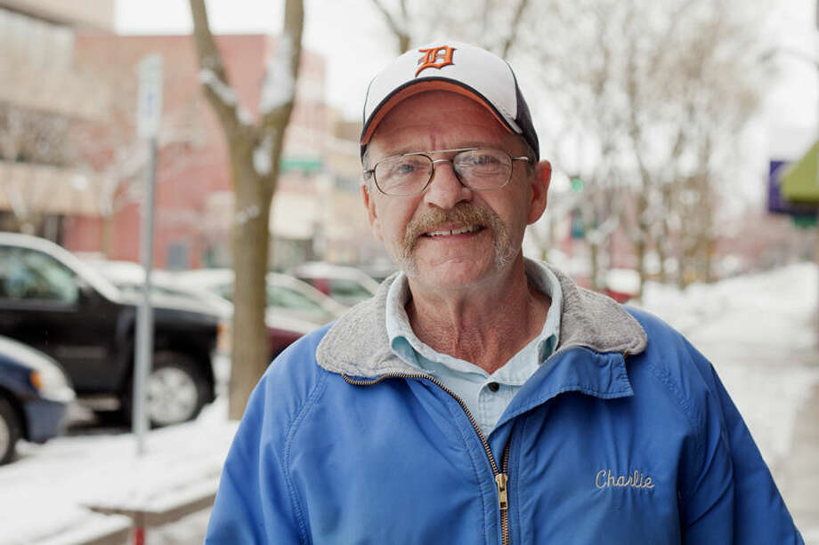 Charlie Malenfant stands on Main Street in Midland along the route that he covered before retiring on Dec. 31. Photo: Neil Blake/Midland Daily News