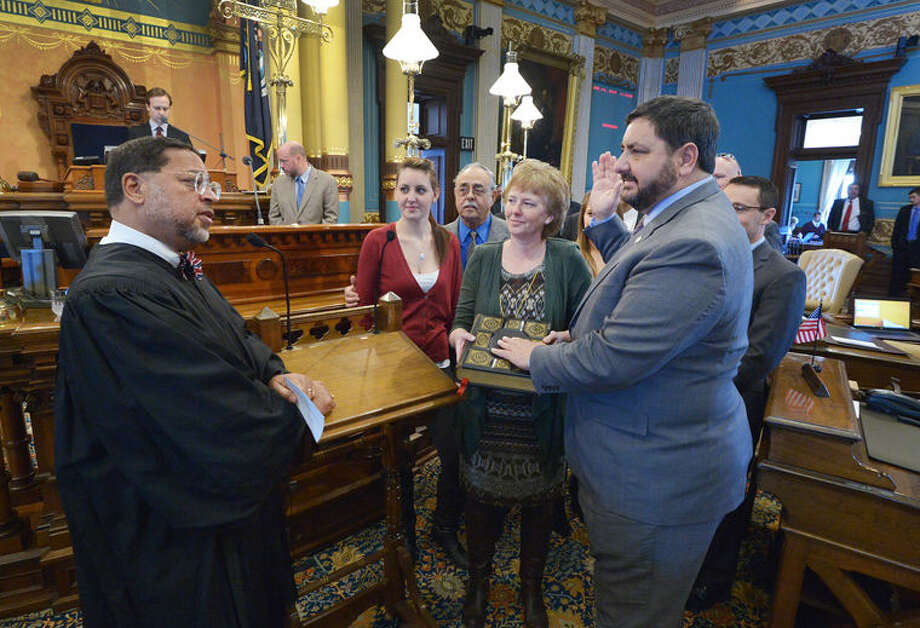 Michigan Supreme Court Chief Justice Robert P. Young Jr. administered the oath of office to Sen. Jim Stamas Wednesday. Photo: Photo Provided