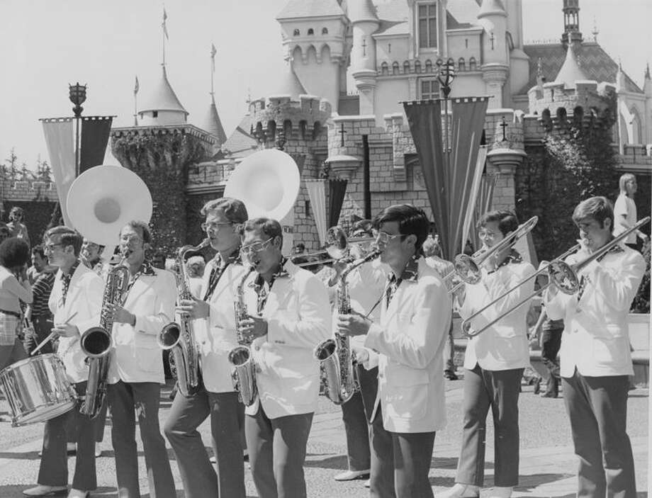 The summer of 1973 found Dana in Disneyland playing in the marching band during the day and playing the piano in concerts in the evening.  Dana is fourth from the left in this photo. He had his choice between Disneyworld in Florida and Disneyland in California and he chose California. Photo: Photo Provided