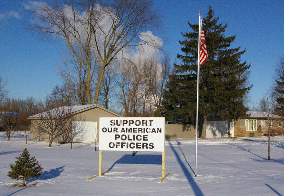 Midland Township resident Patrick Abbott had this sign made to show his support for the work police officers and sheriff's deputies do. Photo: Niky House | For The Daily News
