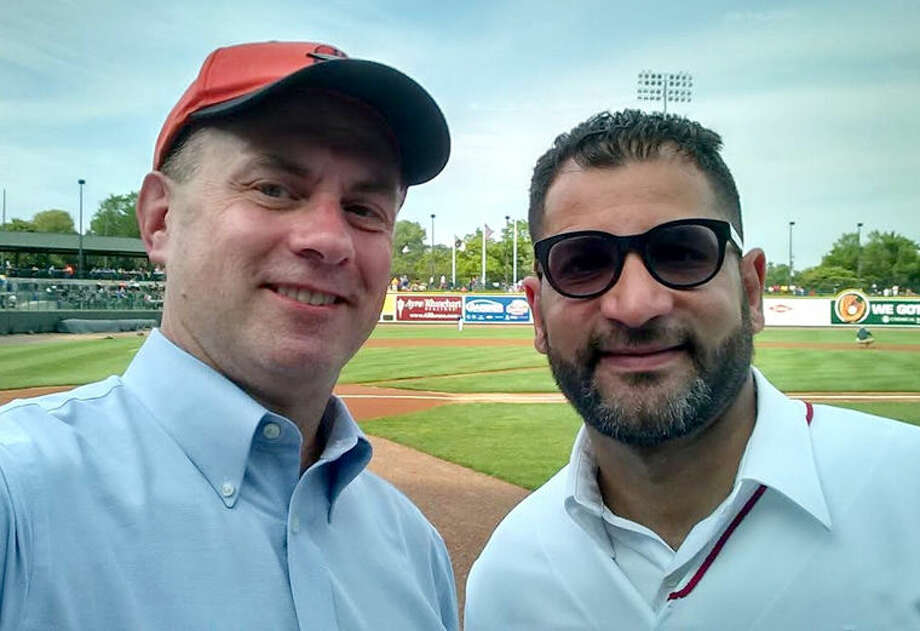 "Rep. Gary Glenn, R-Midland, left, and Rep. Harvey Santana, D-Detroit, at ""Latino Night at the Loons,"" Midland's minor league baseball team, the Great Lakes Loons. Photo: Photo Provided"