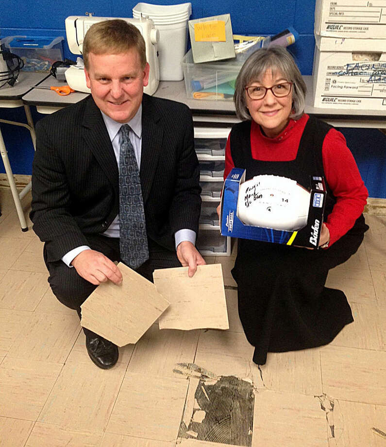 Pictured are Karl Ieuter of Ieuter Insurance Group, holding some of the bad tiles, and Carol Rumba, executive director of Creative 360. Photo: Photo Provided