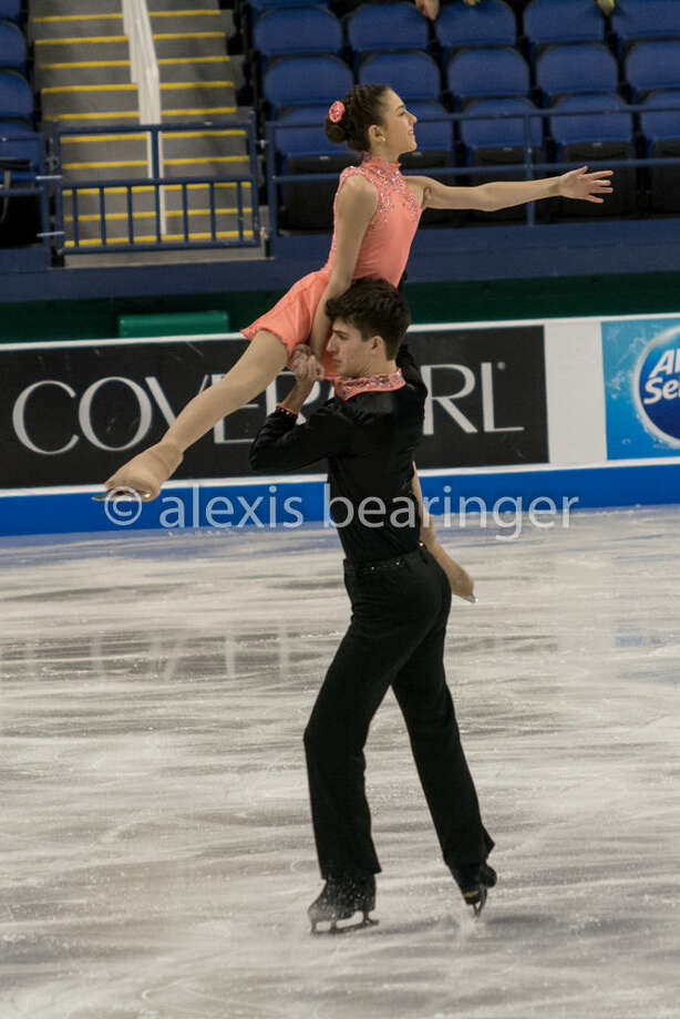 Photo by Alexis BearingerMidland's Keyton Bearinger lifts partner Dana Vulaj during their pairs performance at the U.S. Figure Skating Championships on Jan. 17 in Greensboro, N.C.