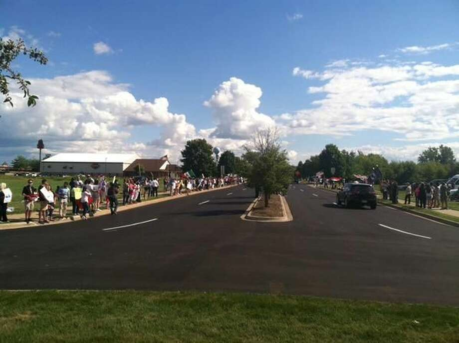 Protesters line either side of Beyer Road up to Birch Run Expo Center, where Republican presidential candidate Donald Trump is scheduled to speak tonight at 6:30 p.m.
