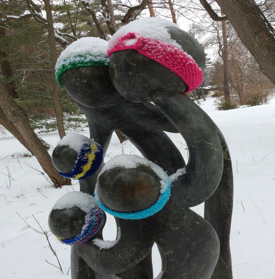 "Head bands and scarves appeared on sculptures at Dow Gardens recently thanks to a ""Mystery Knitter."" Photo: STUART FROHM 