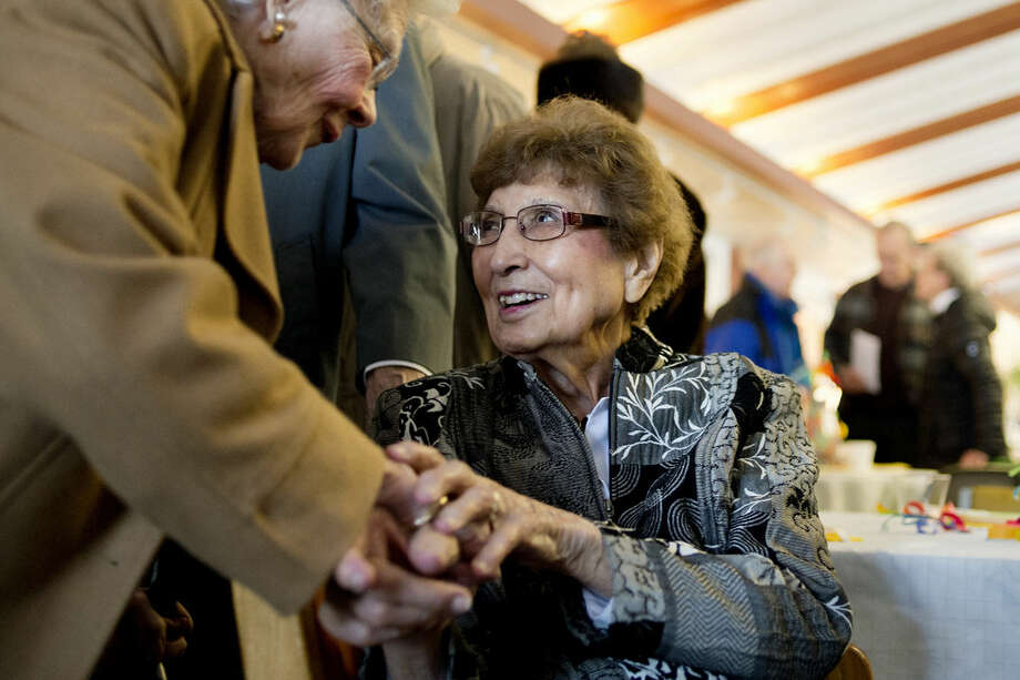 "Mildred Putnam of Midland, left, greets Virginia Sears on her 100th birthday on Tuesday at a party held in her honor at Creative 360. Sears taught at Sugnet Elementary School and many of her former students attended the celebration. ""I appreciate all of you coming here today,"" Sears said. ""Because I'm honored. Thank you so much."" Photo: NEIL BLAKE 